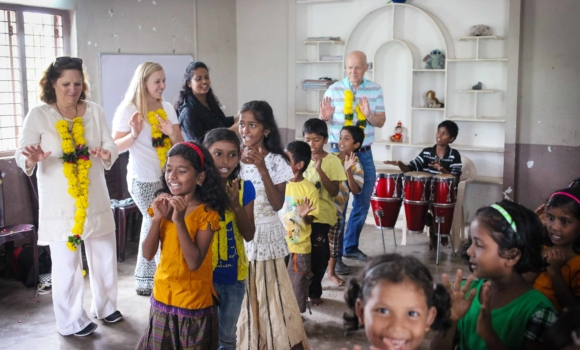 Group of young girls dancing for home visitors