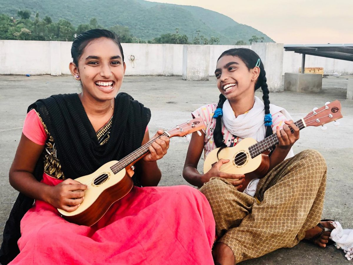 Music Students play ukuleles a Children of faith