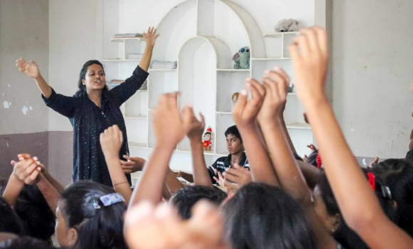 Rosie Thandu leads the children in an activity at the Children of Faith Home