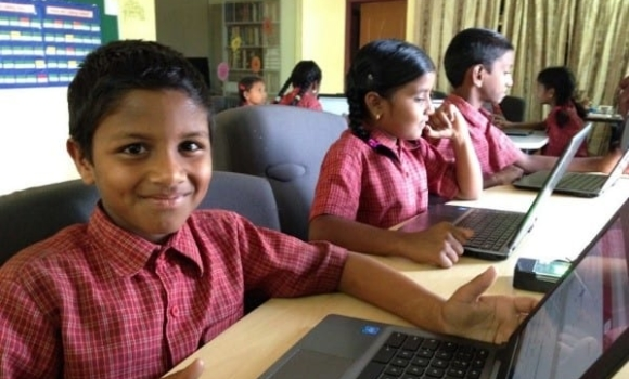 Student works at computer at Children of Faith home-school in India