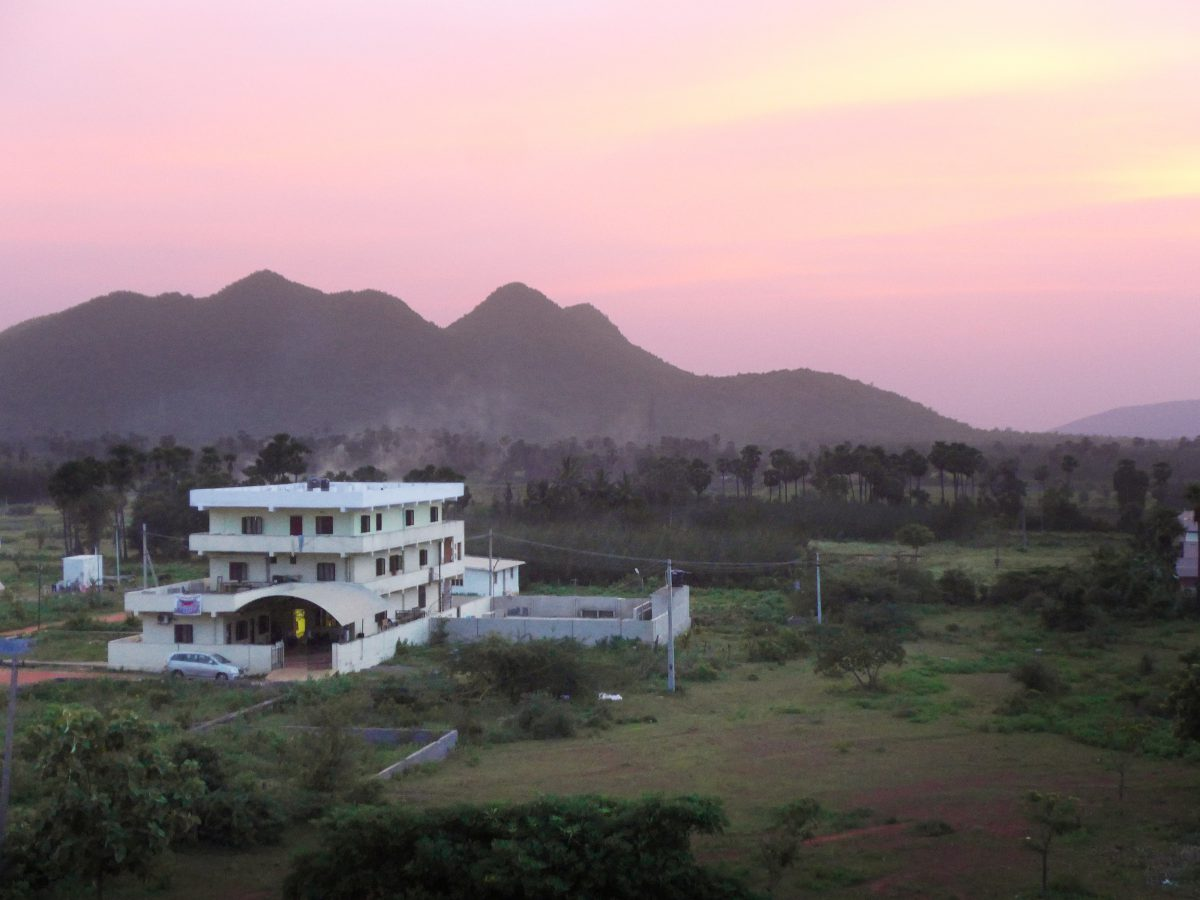 a sunset view of the main Children of Faith campus with hills in the background