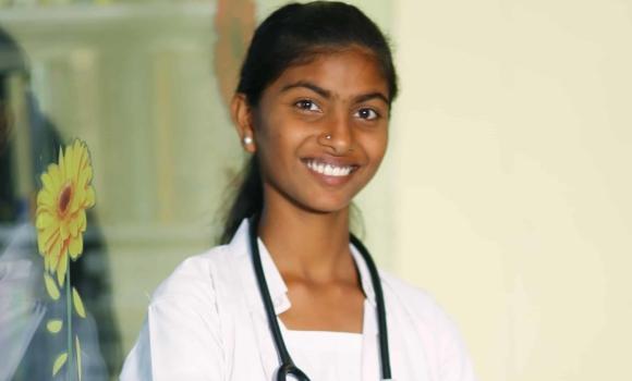 a young woman in a white nurses uniform copy