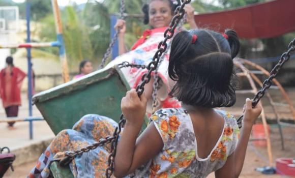 girls playing on swings