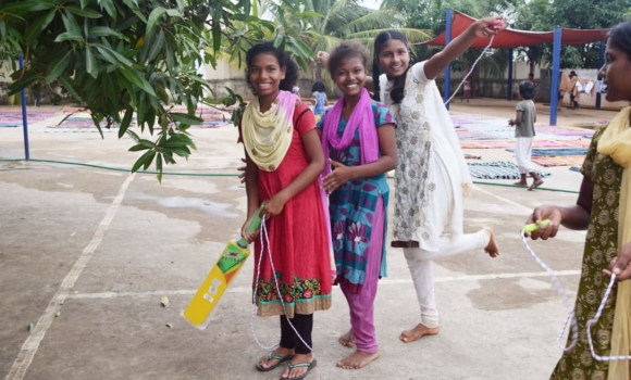 group of girls with jump rope and cricket bat