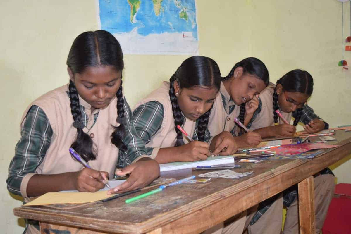 group of girls working on homework