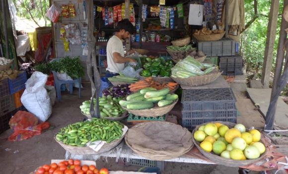 man shopping for food at local market