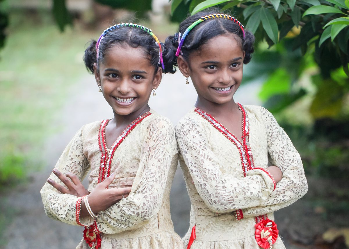 twin sisters posing together in their best dress