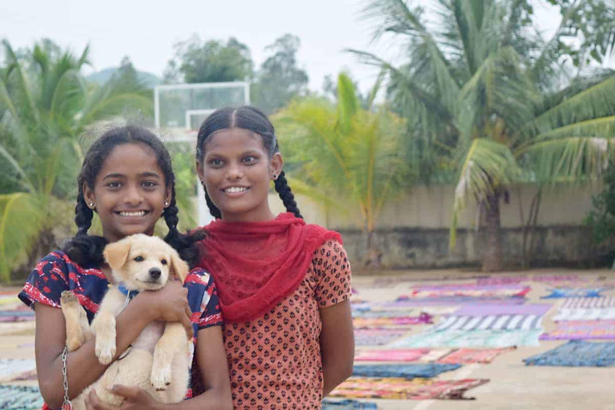 two girls with a puppy