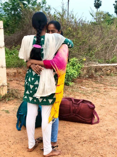 Girls hug and say good-bye in India
