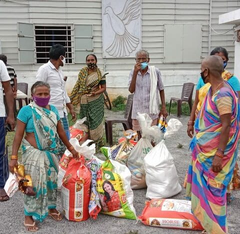 Men and women with supplies at Grocery Distribution event in India