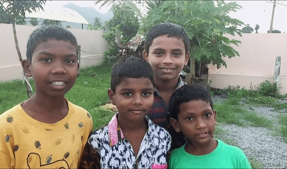 Group of boys posing for the camera before returning to the home.